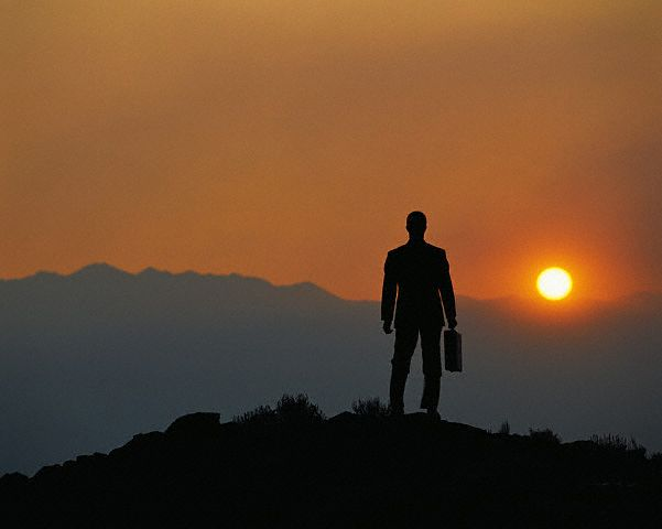 Businessman on Mountaintop